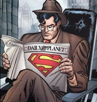 Clark Reading the Daily Planet