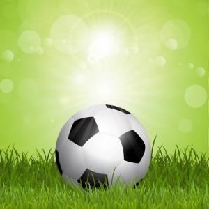 voetbal-achtergrond-met-voetbal-in-het-gras_1048-2173